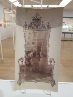 The negative of the photo has been reworked to eliminate the surroundings of the mirror frame, which is though visible in the refleciton!